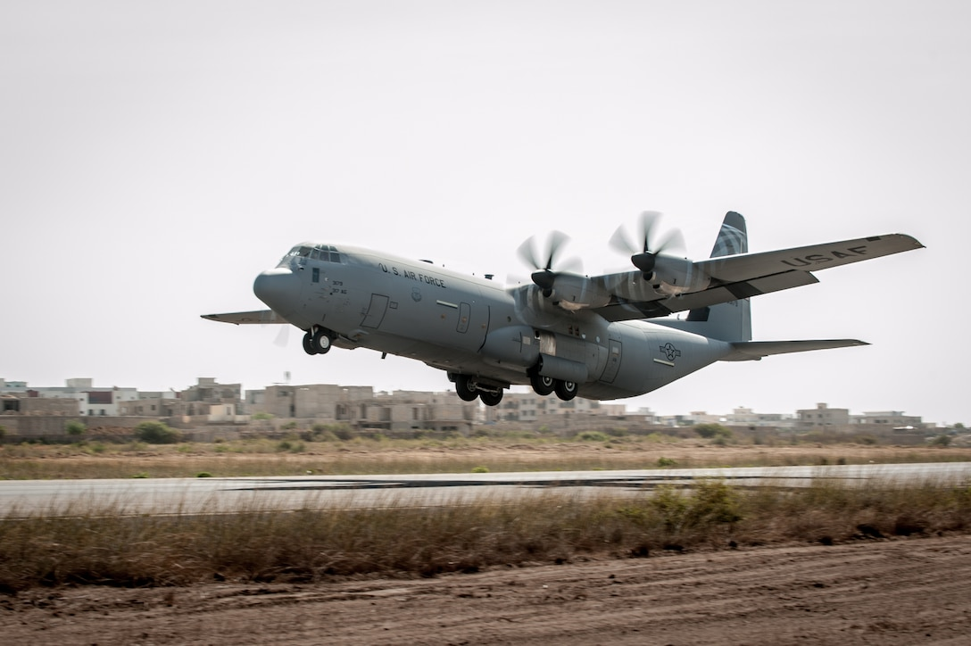 A U.S. Air Force C-130 Hercules takes off from Léopold Sédar Senghor International Airport in Dakar, Senegal, Nov. 4, 2014, en route to Monrovia, Liberia. The aircraft is carrying 8 tons of humanitarian aid and military supplies in support of Operation United Assistance, the U.S. Agency for International Development-led, whole-of-government effort to contain the Ebola virus outbreak in West Africa. (U.S. Air National Guard photo by Maj. Dale Greer)