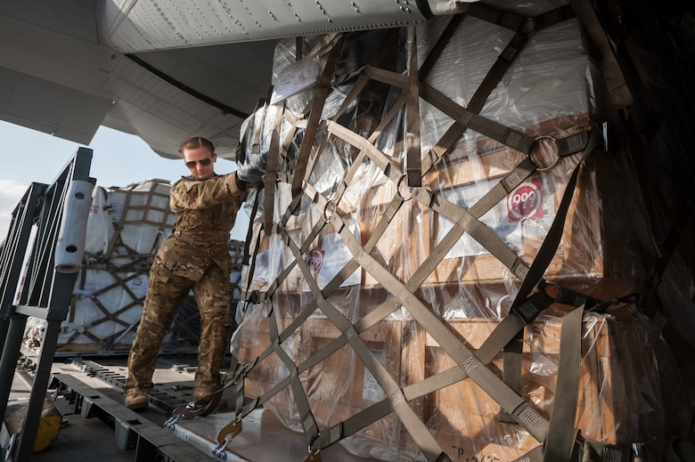 U.S. Air Force Airman 1st Class Teara Sapp, a loadmaster from the 317th Airlift Group at Dyess Air Force Base, Texas, loads a pallet of humanitarian aid and military supplies onto a U.S. Air Force C-130 aircraft at Léopold Sédar Senghor International Airport in Dakar, Senegal, Nov. 4, 2014. Sapp and 35 other Airmen from Dyess are deployed to Senegal as part of the 787th Air Expeditionary Squadron, which is flying cargo into Monrovia, Liberia, in support of Operation United Assistance, the U.S. Agency for International Development-led, whole-of-government effort to contain the Ebola virus outbreak in West Africa. (U.S. Air National Guard photo by Maj. Dale Greer)
