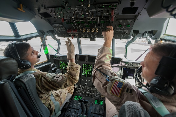 U.S. Air Force Capts. Vincent Levraea (left) and Jason Steinlicht, both pilots from the 317th Airlift Group at Dyess Air Force Base, Texas, conduct pre-flight checklists at Léopold Sédar Senghor International Airport in Dakar, Senegal, Nov. 4, 2014. The pilots are preparing to fly a sortie into Monrovia, Liberia, to deliver more than 8 tons of humanitarian aid and military supplies in support of Operation United Assistance, the U.S. Agency for International Development-led, whole-of-government effort to contain the Ebola virus outbreak in West Africa. (U.S. Air National Guard photo by Maj. Dale Greer)