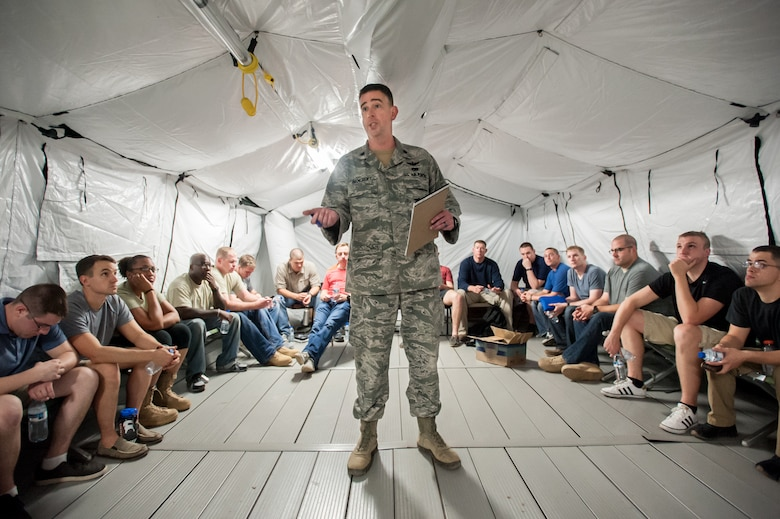 U.S. Air Force Lt. Col. Bruce Bancroft of the Kentucky Air National Guard's 123rd Contingency Response Group briefs Airmen as they arrive at Léopold Sédar Senghor International Airport in Dakar, Senegal, Nov. 2, 2014. The Airmen, from Dyess Air Force Base, Texas, are standing up the 787th Air Expeditionary Squadron to fly humanitarian aid and military support cargo into Liberia as part of Operation United Assistance, the U.S. Agency for International Development-led, whole-of-government effort to contain the Ebola virus outbreak in West Africa. (U.S. Air National Guard photo by Maj. Dale Greer)