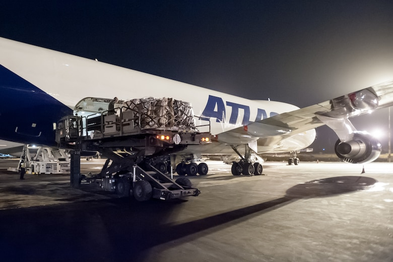 Aerial porters from Kentucky Air National Guard's 123rd Contingency Response Group off-load 85 tons of humanitarian aid from a 747 cargo plane at Léopold Sédar Senghor International Airport in Dakar, Senegal, Nov. 2, 2014. The cargo, which includes medical supplies and troop-support equipment, will be staged in a nearby cargo yard before being airlifted to Liberia aboard U.S. Air Force C-130s in support of Operation United Assistance, the U.S. Agency for International Development-led, whole-of-government effort to contain the Ebola virus outbreak in West Africa. (U.S. Air National Guard photo by Maj. Dale Greer)