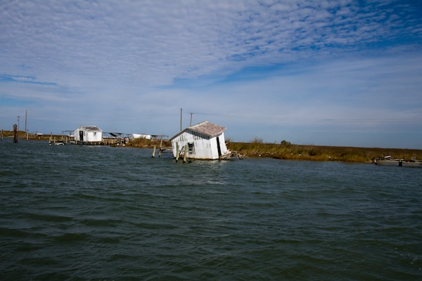 TANGIER, Va. -- A damaged shack that once housed equipment used by watermen on Tangier Island sits empty along the harbor here November 3, 2014. The Norfolk District, U.S. Army Corps of Engineers is working on a breakwater that will help protect the boats and shacks in the harbor from damaging wave attack during coastal storms.