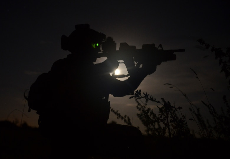 A special operations Airman aims his weapon to designate the location of a threat Oct. 9, 2014, during a training mission at Stanford Training Area near Thetford, England. Operators can equip their weapons with various tools like infrared lasers to help them accomplish their mission. (U.S. Air Force photo/Staff Sgt. Micaiah Anthony)