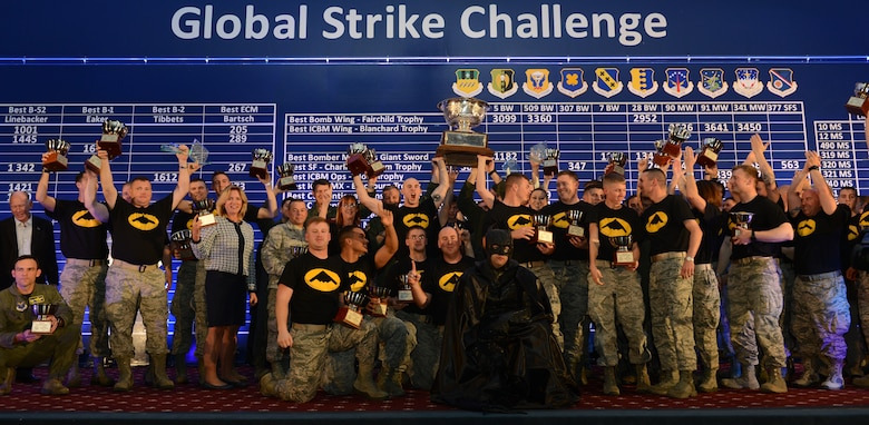 The total-force team of the 509th Bomb Wing and the 131st Bomb Wing wins the Fairchild Trophy for best bomb wing in the Air Force Nov. 5, 2014, at the 2014 Global Strike Challenge (GSC) score posting, hosted at Barksdale Air Force Base, La. After months of fierce competition, the 'best of the best' were named among GSC teams around Air Force Global Strike Command, Air Combat Command, Air Force Reserve Command the Air National Guard. The 509th BW and the 131st BW are based at Whiteman AFB, Mo. (U.S. Air Force photo/Senior Airman Benjamin Gonsier)