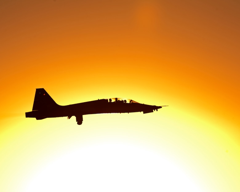 A student pilot from the 80th Flying Training Wing assigned to the Euro-NATO Joint Jet Pilot training (ENJJPT) program takes off at sunrise in a T-38 Talon Oct. 30, 2014, at Sheppard Air Force Base, Texas. The ENJJPT program is a challenging and rigorous 55-week course that tests pilots' nerves and produces some of the best pilots in the world. (U.S. Air Force photo/Danny Webb)