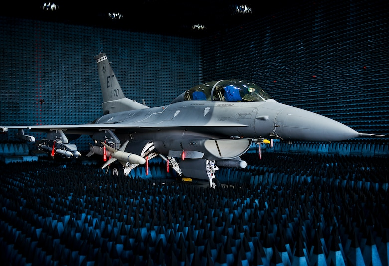 A 40th Flight Test Squadron F-16 Fighting Falcon sits in the anechoic chamber after completion of the initial round of testing simulations on the new M-7 software upgrade Oct. 30, 2014, at Eglin Air Force Base, Fla. The M-7 software package will provide multiple advanced capabilities to the aircraft. The anechoic chamber is a room designed to stop reflections of either sound or electromagnetic waves. The room is insulated from exterior sources of noise. The room is part of a facility that allows testing of air-to-air and air-to-surface munitions and electronics systems on full-scale aircraft and land vehicles prior to open-air testing. (U.S. Air Force photo/Samuel King Jr.)
