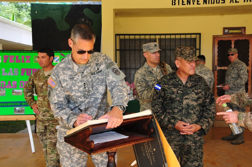 U.S. Army Lt. Gen. Ken Tovo, SOUTHCOM military deputy commander signs the distinguished visitors log book at the Honduran 5th Infantry Battalion in Mocoron, Honduras, Oct. 5, 2014. U.S. Southern Command senior leaders met with Honduran military leaders, where they received briefings and had the opportunity to discuss key issues with Honduran military leadership, to include the concerns of the Gracias a Dios region. The leadership engagement was an exceptional opportunity to follow up with the SOUTHCOM commanding general, General John Kelly's commitment to the leaders of Honduras, to recognize the situational challenges, identify support needed in order to build and sustain enduring partnerships and promote security, stability and prosperity throughout Central America.