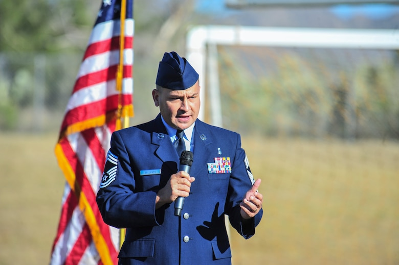 U.S. Air Force Chief Master Sgt. Chad Ballance, 355th Medical Group superintendent, speaks during a Veterans Day Assembly at Richard B. Wilson K-8 School, Tucson, Ariz., Nov. 7, 2014.  Ballance spoke about veterans who paid the ultimate sacrifice to protect the safety and freedoms of the U.S.  (U.S. Air Force Photo by Airman 1st Class Chris Massey/Released)