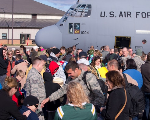 U.S. Air Force airmen from the 133rd Airlift Wing reunite with their families and friends in St. Paul, Minn., Nov. 6, 2014.  Nearly 100 airmen from the 133rd Airlift Wing were deployed to Southeast Asia for four months in support of Operation Enduring Freedom.  (U.S. Air National Guard photo by Tech. Sgt. Amy M. Lovgren/ Released)