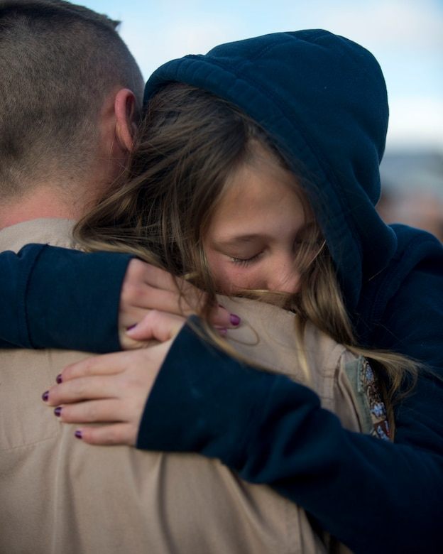 Maj. Andrew Torzewski, 109th Aerial Squadron, reunites with his family and friends in St. Paul, Minn., Nov. 6, 2014.  Torzewski and nearly 100 other airmen from the 133rd Airlift Wing were deployed to Southeast Asia for four months in Support of Operation Enduring Freedom.  (U.S. Air National Guard photo by Tech. Sgt. Amy M. Lovgren/ Released)