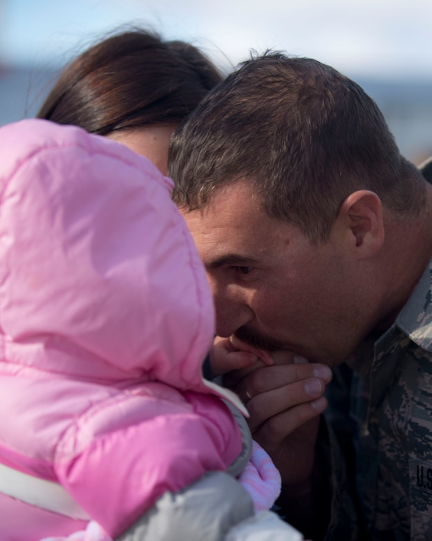 Tech Sgt. Adrian Skadsem, 133rd Maintenance Squadron, reunites with his family and friends in St. Paul, Minn., Nov. 6, 2014.  Skadsem and nearly 100 other airmen from the 133rd Airlift Wing were deployed to Southeast Asia for four months in Support of Operation Enduring Freedom. (U.S. Air National Guard photo by Tech. Sgt. Amy M. Lovgren/ Released)