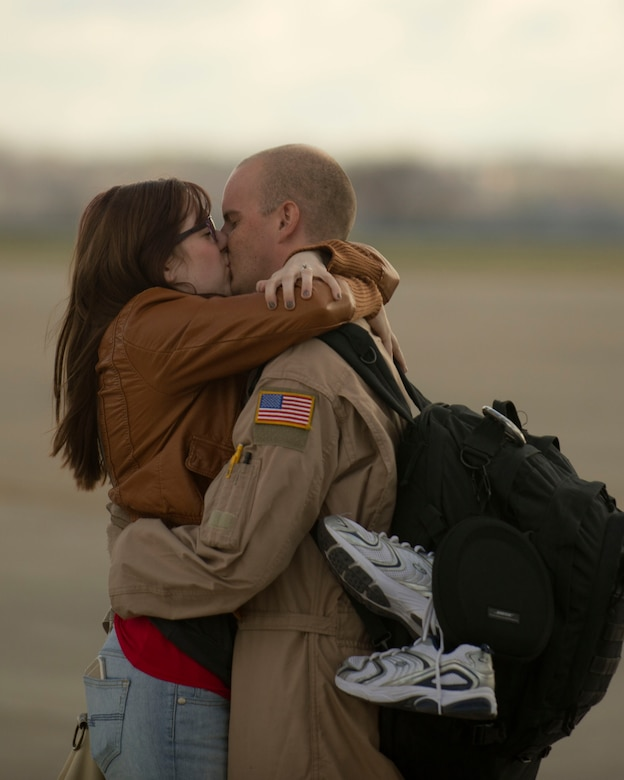 Staff Sgt Travis Green, 109th Aerial Squadron, reunites with his spouse in St. Paul, Minn., Nov. 6, 2014.  Staff Sgt. Green returned to Minnesota after a four month deployment to Southwest Asia in support of Operation Enduring Freedom. (U.S. Air National Guard photo by Tech. Sgt. Amy M. Lovgren/ Released)