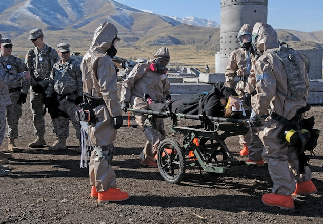 Members of the Utah National Guard Chemical, Biological, Radiological, Nuclear (CBRN) Enhanced Response Force Package (CERFP) and Homeland Response Force (HRF) extract and treat mock casualties from a simulated rubble pile in Magna, Utah during Vigilant Guard on November 4, 2014. The training exercise simulated a building collapse and chemically contaminated area as part of an earthquake disaster scenario. (Air National Guard photo by Staff Sgt. Annie Edwards/RELEASED)