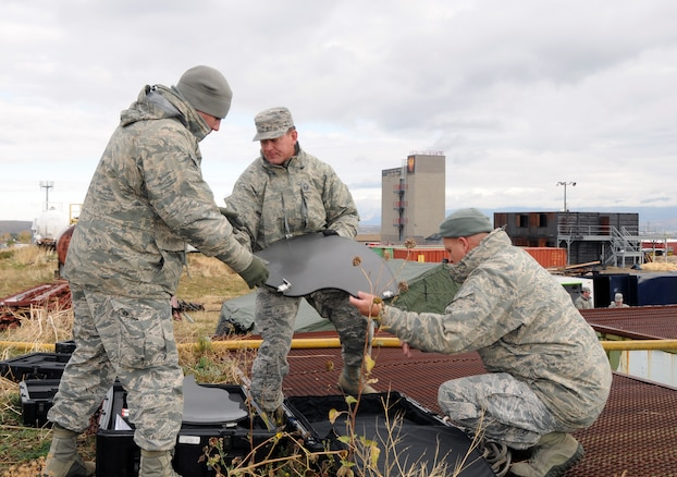 Members of the 151st Communications Flight set up satellite communications at the Magna, Utah rubble pile on November 3, 2014 during the Vigilant Guard training exercise. (Air National Guard photo by Staff Sgt. Annie Edwards/RELEASED)