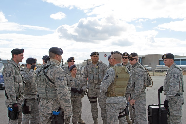 Master Sgt. Brian Atchley briefs members of the 151st Air Refueling Wing Security Forces Squadron as they prepare to assist in securing Questar Village in Salt Lake City, Utah  as part of a training exercise during Vigilant Guard on November 3, 2014. (U.S. Army photo by Sgt. Christopher Lennox/Released)