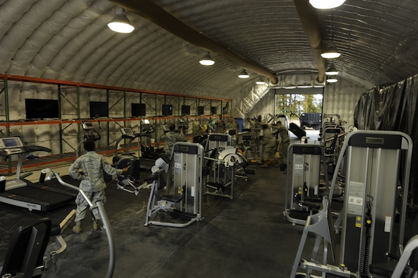 Airmen assigned to the 633rd Force Support Squadron set up gym equipment at the Langley Transit