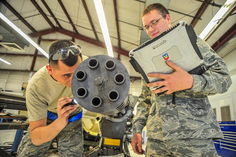 U.S. Air Force Airmen 1st Class Nicholas Danley and Mason Roberts, 355th Equipment Maintenance Squadron weapons armament technicians, inspect a GAU-8/A Gatling gun to ensure the roll-pin is installed and the muzzle clamp bolt safety wire is intact at Davis-Monthan Air Force Base, Ariz., Nov. 6, 2014. The muzzle clamp retains all seven barrels of the gun to keep them secure and in place while being fired.  (U.S. Air Force Photo by Airman 1st Class Chris Massey/Released)