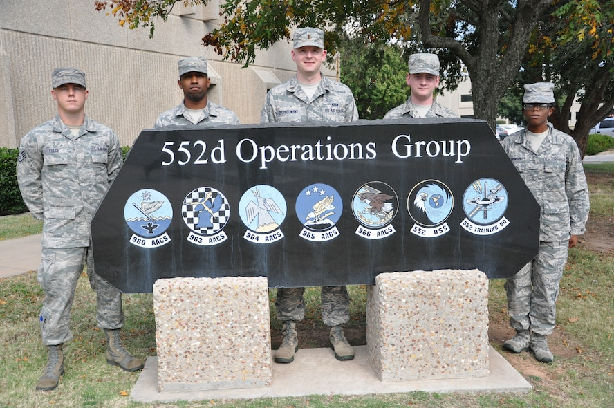 From left, Staff Sgt. Matthew Fulce, Airman 1st Class Frederick Thomas, 2nd Lt. Dawid Grzybowski, Airman 1st Class Ryan O'Gallager and Airman 1st Class Azelia Robinson are the first graduates of the new Air Force-wide E-3 Intelligence Initial Qualification Course. These five Airmen from the 552nd Air Control Wing graduated from the course Oct. 21. (Air Force photo by Darren D. Heusel)