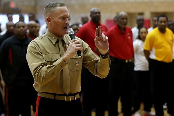 Brig. Gen. Edward Banta speaks at the opening ceremony of the Armed Forces Basketball Championship at the Paige Fieldhouse, Nov. 7. The championship consists of a men and womens team from each of the four branches. The tournament is from Nov. 7-13 and the best players from the tournament will be selected to play on the All-Armed Forces Team in December in Belgium. Banta is the Commanding General of Marine Corps Installations West-Marine Corps Base Camp Pendleton. (Photo by Cpl. Keenan Zelazoski)