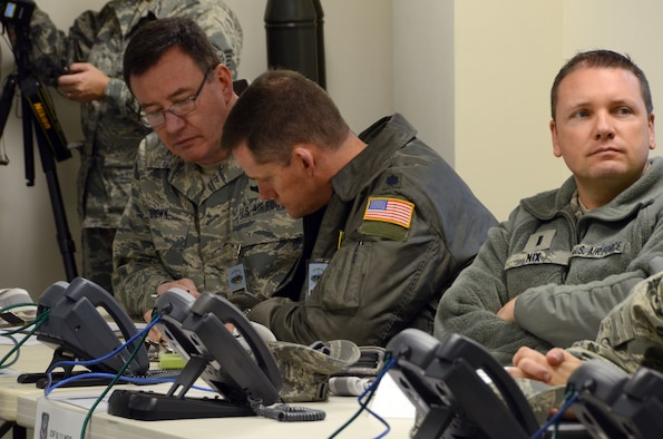 U.S. Air Force Col. Thomas W. Brown, Jr., 145th Airlift Wing, Air Operations Officer, Lt. Col. Miles K. Harkey, commander, 145th Operations Support Squadron and 1st Lt. Michael V. Nix, 145th Maintenance Squadron, all members of the Wing Inspection Team (WIT), review the Master Scenario Event List (MSEL) prior to the Anti-Terrorism Exercise held Nov. 1, 2014, at the North Carolina Air National Guard Base, Charlotte Douglas Intl. Airport. The annual Anti-Terrorism Exercise simulated a car-bomb detonation inside the perimeter of the air base. The exercise initiated force protection measures across the base and tested the Wing's ability to respond accordingly. After the car-bomb detonation, Airmen also performed simulated search and recovery procedures. (U.S. Air National Guard photo by Master Sgt. Patricia F. Moran, 145th Public Affairs/Released)