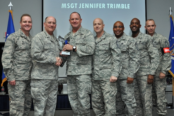Lt. Gen. James Jackson, chief of the Air Force Reserve, Headquarters U.S. Air Force Washington, D.C., presents the Recruiter Service Personnel Support Person of the Year Award to Col. Chris Funk, 482nd Fighter Wing commander, Homestead Air Reserve Base, Fla., who accepts on behalf of Master Sgt. Jennifer Trimble, chief of career development for the 482nd Force Support Squadron at Homestead ARB, during the Recruit National Awards Banquet at the Combat Readiness Training Center in Savannah, Ga. Trimble received this award because of her professionalism and diligence while aiding nationwide recruiting efforts. (Courtesy photo)