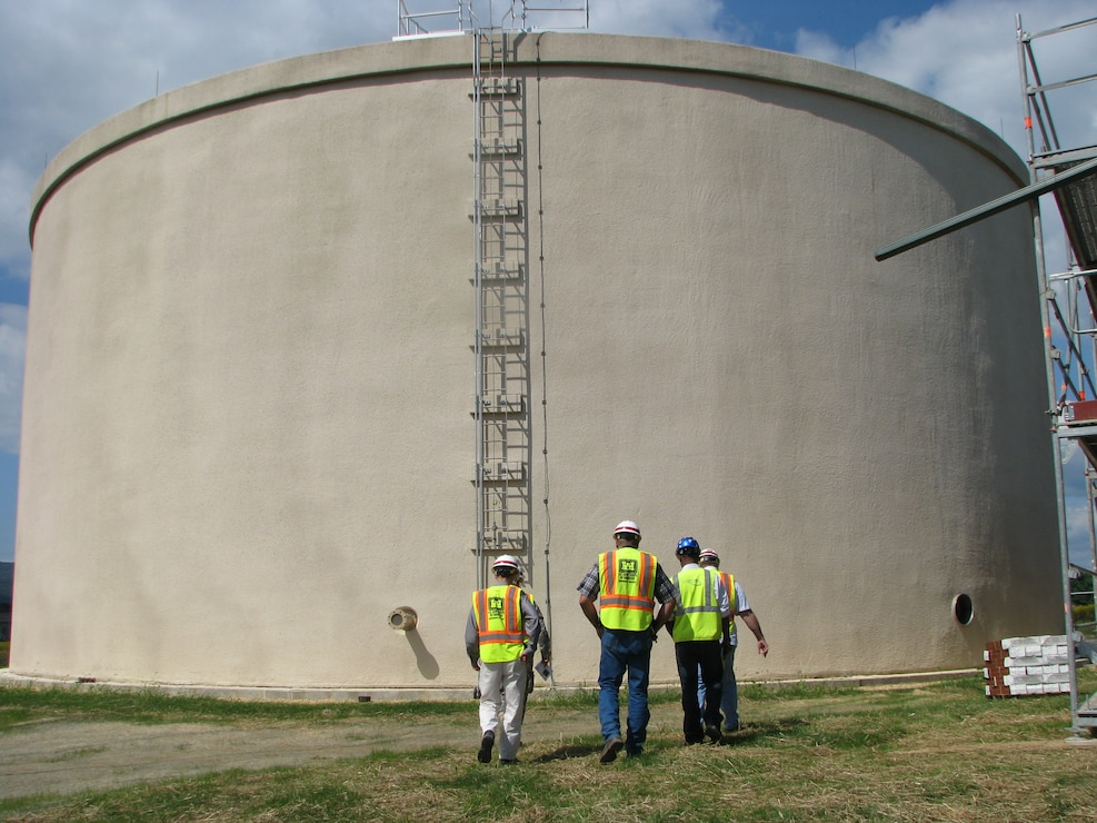 U.S. Army Corps of Engineers, Baltimore District, officials examine the supplemental two milliion gallon water storage tank on Fort Detrick, Md.