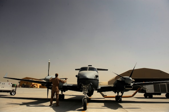 Airmen from the 361st Expeditionary Reconnaissance Squadron prepare an MC-12W Liberty for operations Aug. 25, 2010, on Kandahar Airfield, Afghan.  The MC-12W provides full-motion video and signals intelligence to assist battlefield commanders. (U.S. Air Force photo/Staff Sgt. Eric Harris)