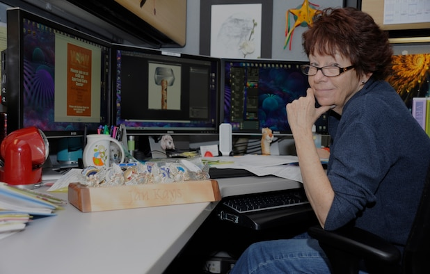 Jan Kays, 30th Space Wing Public Affairs visual information artist, poses in her work environment, Nov. 7, 2014, Vandenberg Air Force Base, Calif. Veterans Day is a nationally celebrated holiday that honors those who have served in the United States Armed Forces. (U.S. Air Force photo by Airman Robert J. Volio/Released)