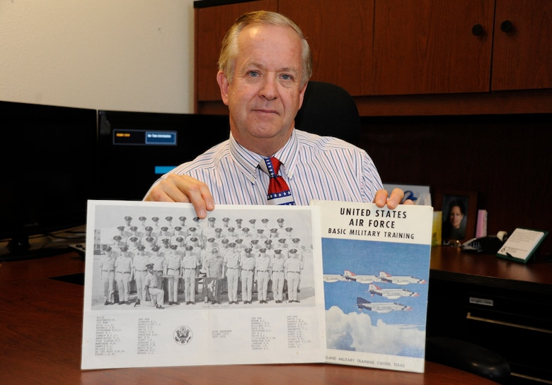 Lynn Coggins, 533rd Training Squadron chief of training management flight, poses with a photo of his flight from Basic Military Training, Nov. 7, 2014, Vandenberg Air Force Base, Calif. Veterans Day is a nationally celebrated holiday that honors those who have served in the United States Armed Forces. (U.S. Air Force photo by Airman Robert J. Volio/Released)