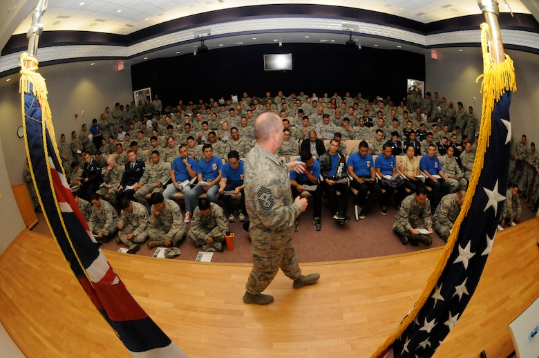 U.S. Air Force Chief Master Sgt. James W. Hotaling, command chief master sergeant of the Air National Guard, address Airman from the 154 Wing, Hawaii Air National Guard, during a Town Hall Meeting at Joint Base Pearl Harbor Hickam on Nov. 9, 2014.  Hotaling encouraged the Airmen to renew their commitment to the profession of arms through the Air Force core values, focus on performance and training, and the deliberate development of Airmen. (U.S. Air National Guard photo by Airman 1st Class Robert Cabuco)
