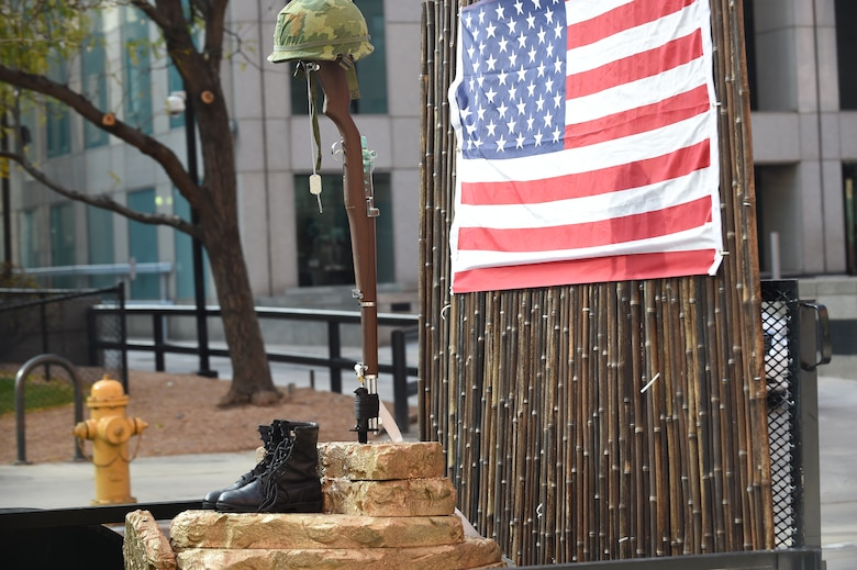 Military boots, a replica rifle and dog tags represent POW/MIA military members during the Veteran's Day Parade, hosted by the Colorado Veterans Project, Nov. 8, 2014, in Denver. The parade consisted of more than 75 groups honoring American veterans by highlighting each American war, beginning with the Revolutionary War and ending with Operation Iraqi Freedom. (U.S. Air Force photo by Airman 1st Class Samantha Saulsbury/Released)