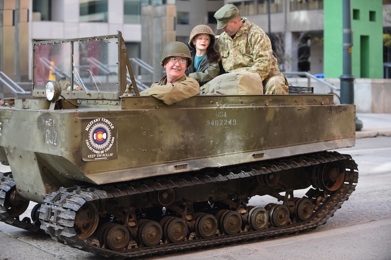 A veteran rides in a classic military vehicle during the Veteran's Day Parade, hosted by the Colorado Veterans Project, Nov. 8, 2014, in Denver. The parade consisted of more than 75 groups honoring American veterans by highlighting each American war, beginning with the Revolutionary War and ending with Operation Iraqi Freedom. (U.S. Air Force photo by Airman 1st Class Samantha Saulsbury/Released)