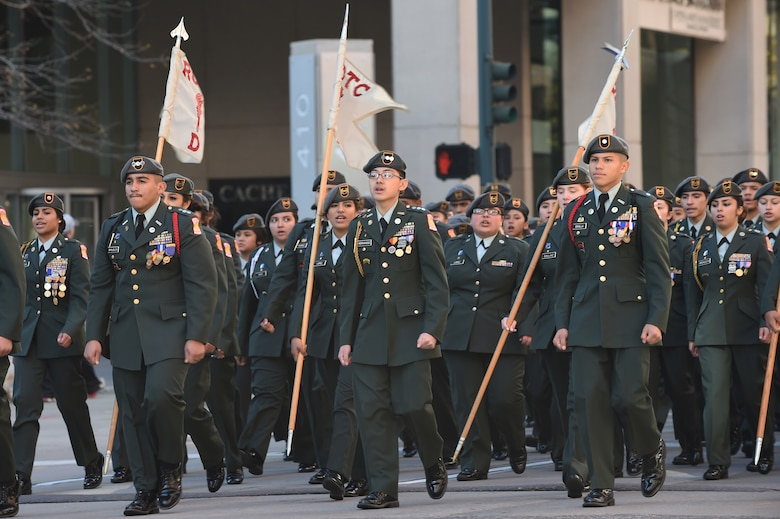 An Army Junior ROTC team marches in the Veteran's Day Parade, hosted by the Colorado Veterans Project,  Nov. 8, 2014, in Denver. The parade consisted of more than 75 groups honoring American veterans by highlighting each American war, beginning with the Revolutionary War and ending with Operation Iraqi Freedom. (U.S. Air Force photo by Airman 1st Class Samantha Saulsbury/Released)