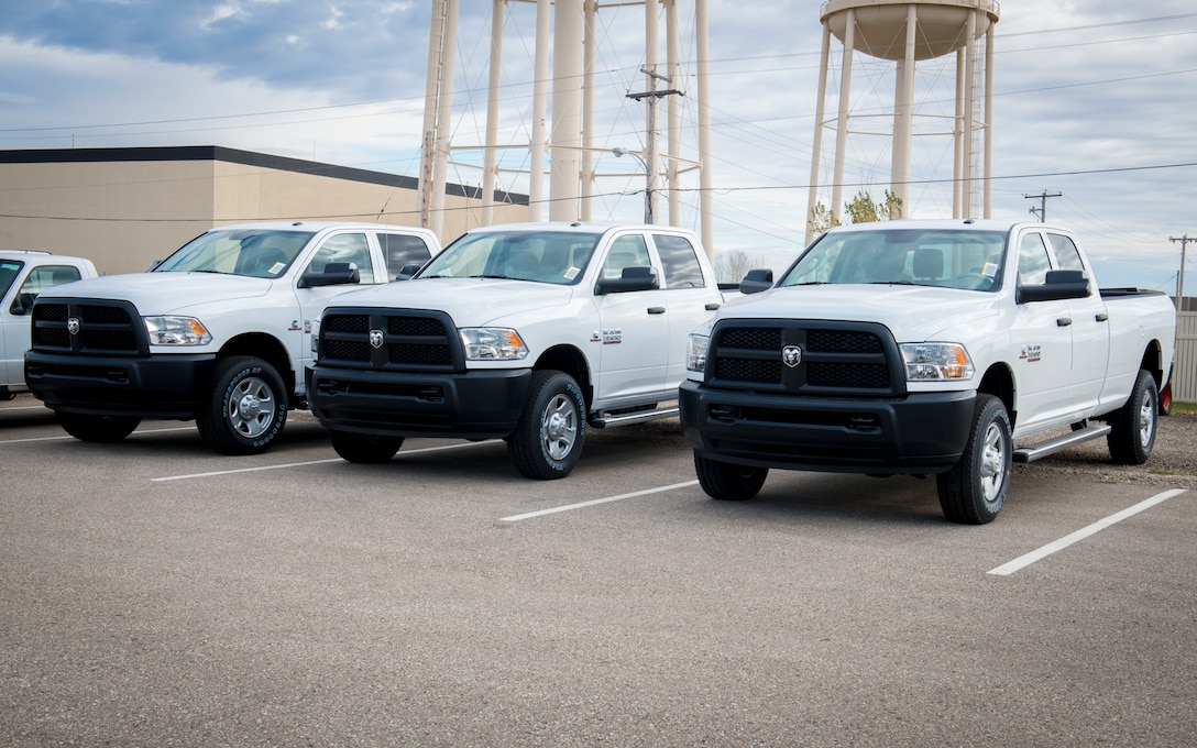Brand new Dodge Ram 3500s sit in a parking lot on Minot Air Force Base, N.D., Oct. 29, 2014. The trucks were bought as a part of the Force Improvement Program's initiative to provide more positive, rapid and substantial changes within the ICBM and bomber missions. Because the old vehicles weren't designed to be on Minot's dirt roads consistently, driving along the roads full of gear and Airmen has worn down the suspension and transmissions over time. (U.S. Air Force photo/Airman 1st Class Sahara L. Fales)
