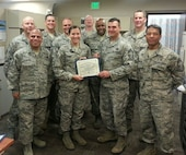 """PETERSON AIR FORCE BASE, Colo. -- The Chiefs Group presented its """"Chiefs' Choice"""" award Nov. 6 to Staff Sgt. Cerrissa Witte in recognition of her professionalism, positive attitude and care provided to her patients. Witte works in the 21st Medical Operations Squadron Physical Therapy Clinic. (U.S. Air Force photo)"""