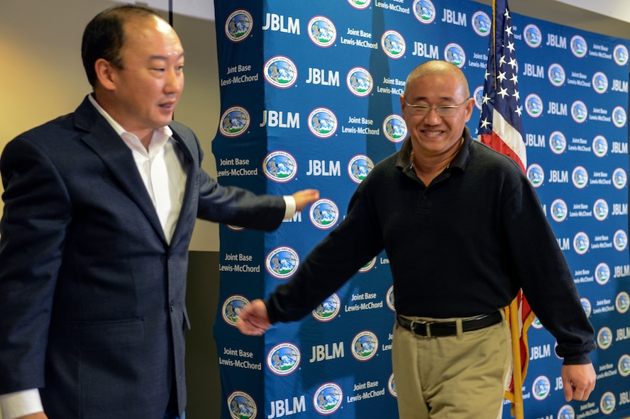 Kenneth Bae, one of the last two American citizens imprisoned in North Korea, smiles after speaking to the media Nov. 8th, 2014, at Joint Base Lewis-McChord, Wash., upon his return to the United States after spending more than two years in a North Korean prison. Bae was accused of plotting to bring down the North Korean government through religious activities late in 2012 and was sentenced to 15 years of hard labor. (U.S. Air Force photo/Staff Sgt. Russ Jackson)