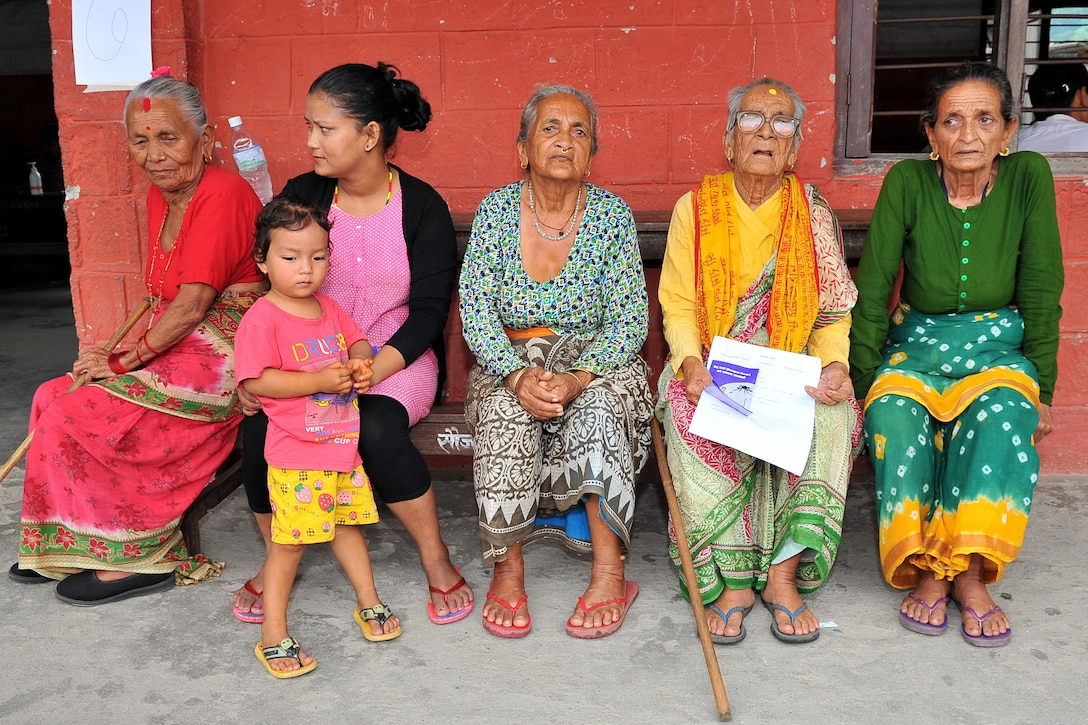 Nepalese women and children wait to be seen by Operation Pacific Angel-Nepal medical providers at a health services outreach site in Manahari, Nepal, Sept. 9, 2014. PACANGEL helps cultivate common bonds and foster goodwill between the U.S., Nepal and regional nations by conducting multilateral humanitarian assistance and civil military operations. (U.S. Air Force photo by Staff Sgt. Melissa B. White)