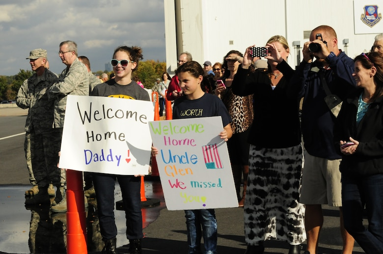 Family members and friends eagerly await the arrival of airmen from the 145th Airlift Wing as they return home to the North Carolina Air National Guard base, Charlotte Douglas Intl Airport, Nov 6, 2014. Over 90 airmen served 120 days while deployed to Qatar where they flew humanitarian supply air drops on Mt. Sinjar in Iraq. They conducted several resupply airdrops to the Iraqi Security Forces and engaged in battle with ISIS. (U.S. Air National Guard photo by Master Sgt. Patricia F. Moran, 145th Public Affairs/Released)