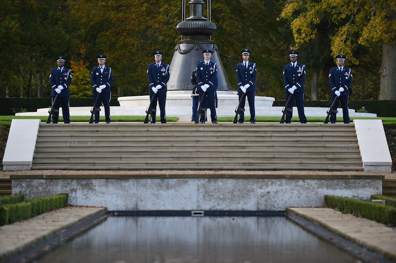 Airmen from the 423rd Air Base Group Honor Guard stand at parade rest prior to firing a volley during a Veterans Day ceremony Nov. 11, 2014, at Cambridge American Cemetery, England. The ceremony honored the 3,812 American Service members buried at the cemetery, along with veterans past and present. (U.S. Air Force photo/Staff Sgt. Jarad A. Denton)