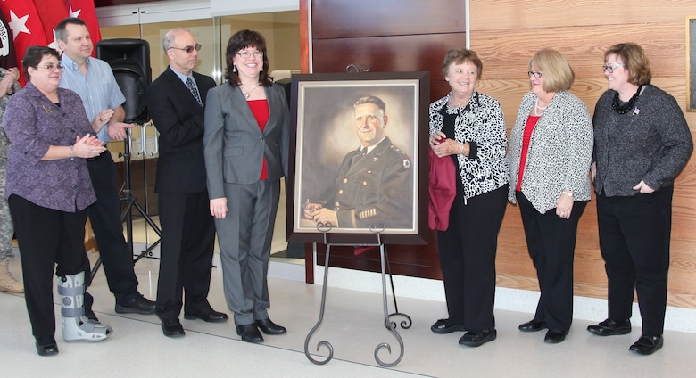 Family members of the late Maj. Gen. Joseph I. Martin unveil a portrait of Martin that will hang in the new Martin Army Community Center set to open Nov. 17. The portrait was dedicated in honor of Martin's accomplishments as a pioneering Army medical practicioner and invaluable contributions to the military medical community.