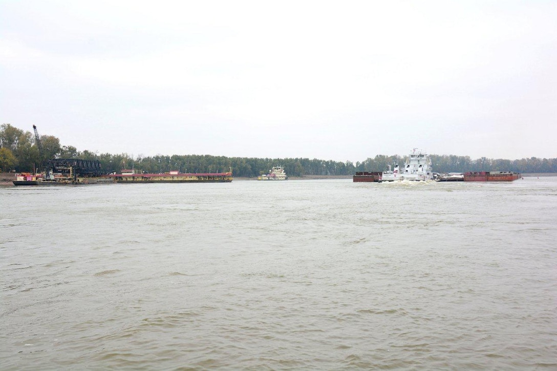 Fair Landing, Arkansas, Nov. 12, 2014 – Northbound commerce with as many as 49 barges moved through the restricted portion of the river at Fair Landing during daylight hours. This helps speed the clearing of the daily queue and reduces the wait time for southbound vessels. Work is also proceeding well in the narrowest reach of the restricted area and the Corps expects normal, unrestricted one-way traffic to resume after Monday, November 17, when the mat sinking unit completes its work in the narrow section and moves to a wider section of Fair Landing.