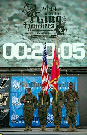 The Combat Center color guard presents the colors during the final day of the 2014 King of the Hammers event in Johnson Valley, Calif., Feb. 7, 2014.