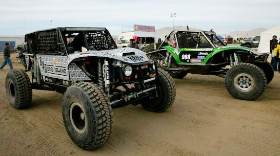 Ultra 4 vehicle drivers make their way to the starting line for the last race of the 2014 King of the Hammers event in Johnson Valley, Calif., Feb. 7, 2014.