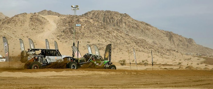 Participants take off from the starting line during the last race of the 2014 King of the Hammers event in Johnson Valley, Calif., Feb. 7, 2014.