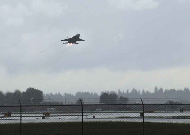 Capt. Ryan Shuck, assigned to the 123rd Fighter Squadron, 142nd Fighter Wing, takes off in Aircraft 84-007, Oct. 23, 2014, Portland Air National Guard Base, Ore. (U.S. Air National photo by Tech. Sgt. John Hughel, 142nd Fighter Wing Public Affairs)