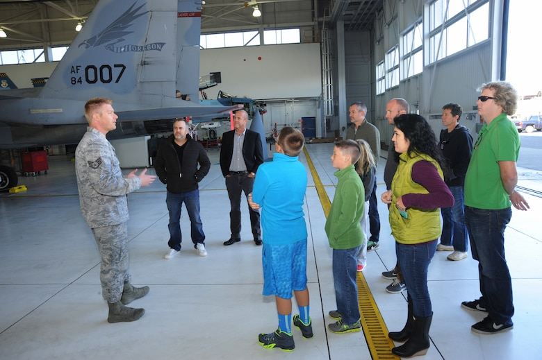 Staff Sgt. Nick Hicks, assigned to the 142nd Fighter Wing Aircraft Maintenance Squadron, leads a tour group around aircraft 84-007, Oct. 16, 2014, a week before the test flight and after nearly two years of repairs, Portland Air National Guard Base, Ore. (U.S. Air National photo by Tech. Sgt. John Hughel, 142nd Fighter Wing Public Affairs)