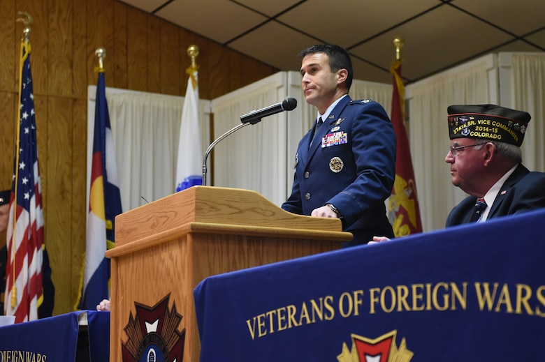Col. John Wagner, 460th Space Wing commander, delivers the keynote speech during the 37th annual Fort Logan National Cemetery Veterans Day remembrance service Nov. 11, 2014, in Englewood, Colo. The observance, moved to Veterans of Foreign Wars Post 9644 due to inclement weather, included several guest speakers, patriotic music and a wreath ceremony in honor of fallen service members. (U.S. Air Force photo by 1st Lt. Trevor Zakrzewski/Released)