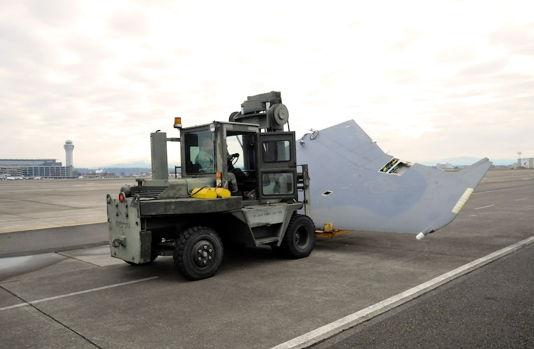 A forklift is used to transport the second wing to another base location, Feb. 4, 2014, Portland Air National Guard Base, Ore. (U.S. Air National photo by Tech. Sgt. John Hughel, 142nd Fighter Wing Public Affairs)