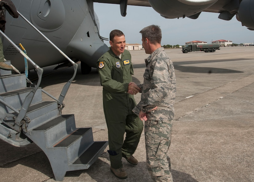 Col. Dan Tulley, 6th Mobility Air Wing commander, greets Col. John Lamontagne, 437th Airlift Wing commander, Nov. 4, 2014, at MacDill Air Force Base, Fla. Lamontagne was hosting the Joint Base Charleston Civic Leaders on a tour highlighting the 6th Air Mobility Wing mission at MacDill AFB. (U.S. Air Force photo / Senior Airman Tom Brading)