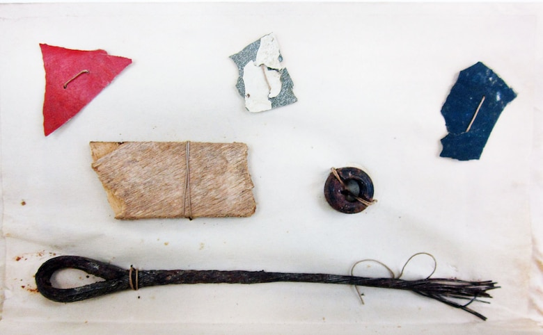 These six pieces of aircraft were taken from Lt. Quentin Roosevelt's Nieuport 28 at the crash site by Sgt. Mark Thatcher on July 14, 1918. There are three small pieces of painted aircraft fabric (red, white, blue), a small piece of wood and two pieces of hardware (nut and wire). Roosevelt, the son of former President Theodore Roosevelt, arrived in France during World War I as a supply officer and trained to become a pilot. As a pilot, he flew a Nieuport 28 with the 95th Aero Squadron. Roosevelt died when his plane was shot down behind German lines by Sgt. Karl Thom, a German ace with 24 victories, on July 14, 1918. (U.S. Air Force photo)